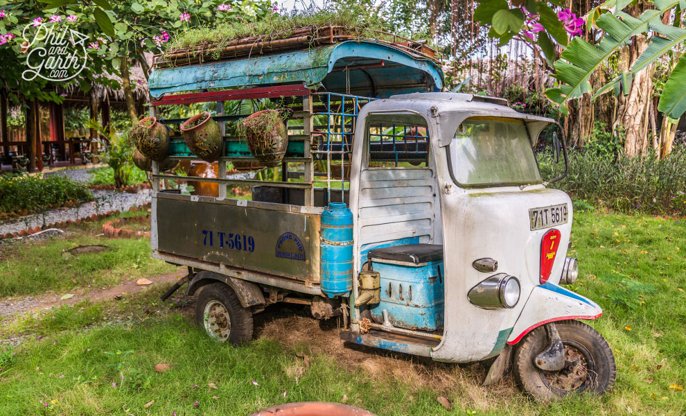 An old tuk tuk for displaying flowers