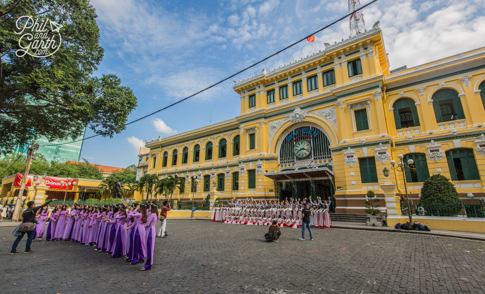 Students having their graduation photos taken outside Saigon's Central Post Office