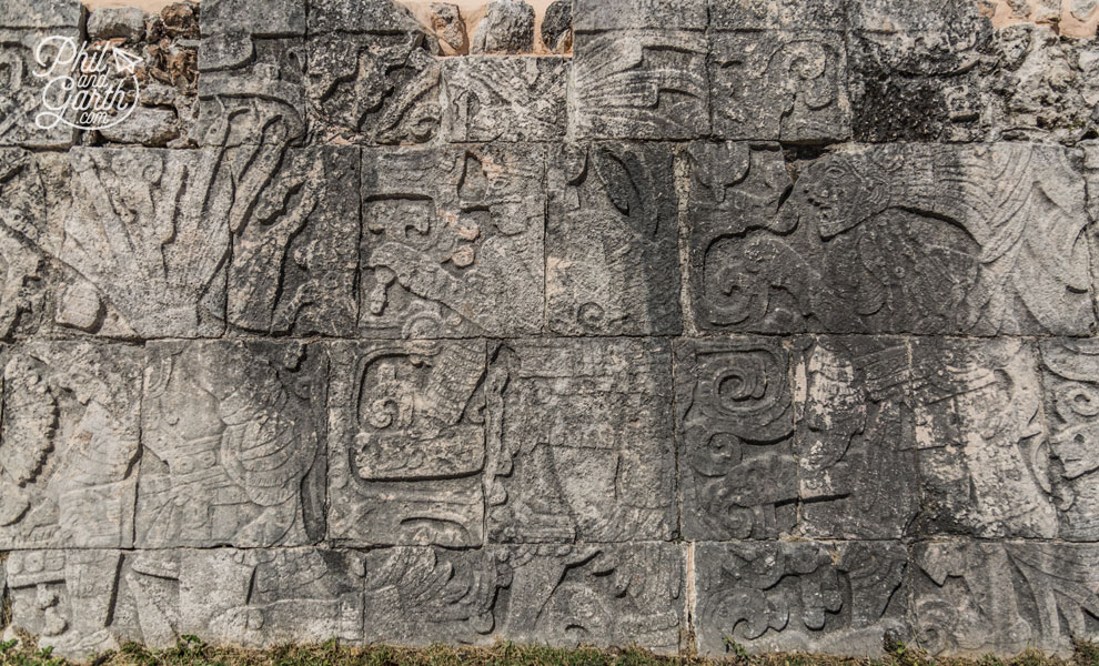 Mayan hieroglyphics along the benches of the Great Ballcourt