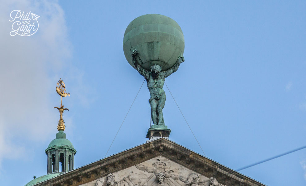 Atlas holding a globe - symbolising Amsterdam's position as a mighty trading port