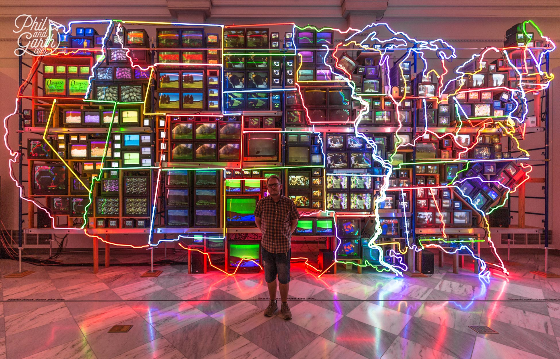 """Garth in front of the """"Electronic Superhighway: Continental U.S., Alaska, Hawaii"""" video installation"""