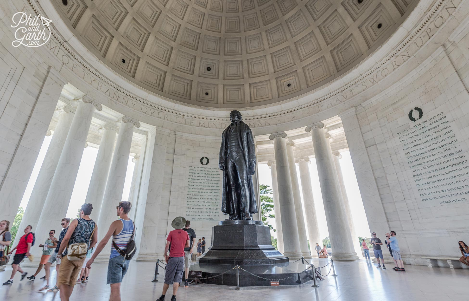 A statue of Thomas Jefferson stands in the middle of the memorial
