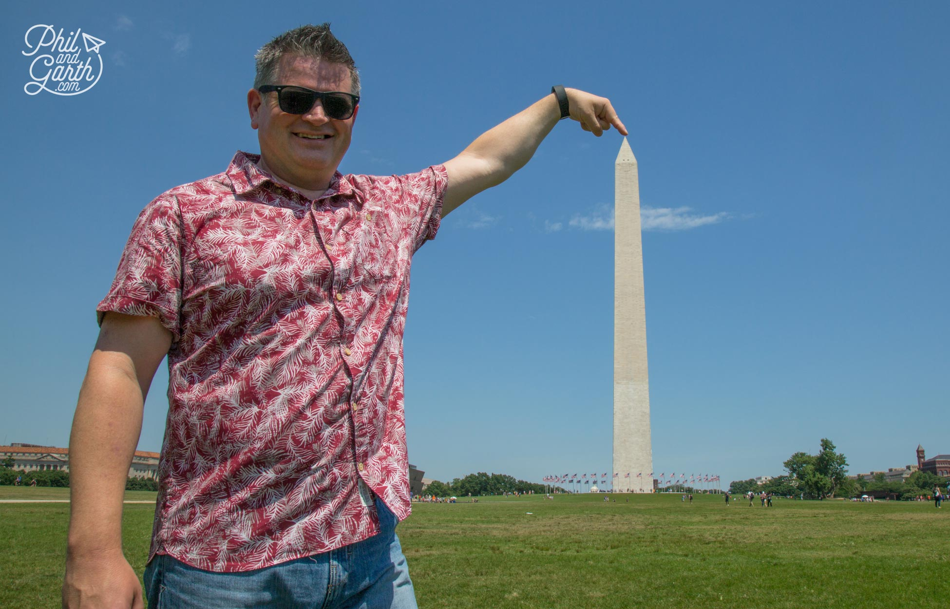 Phil touching the top of the giant pencil aka The Washington Monument