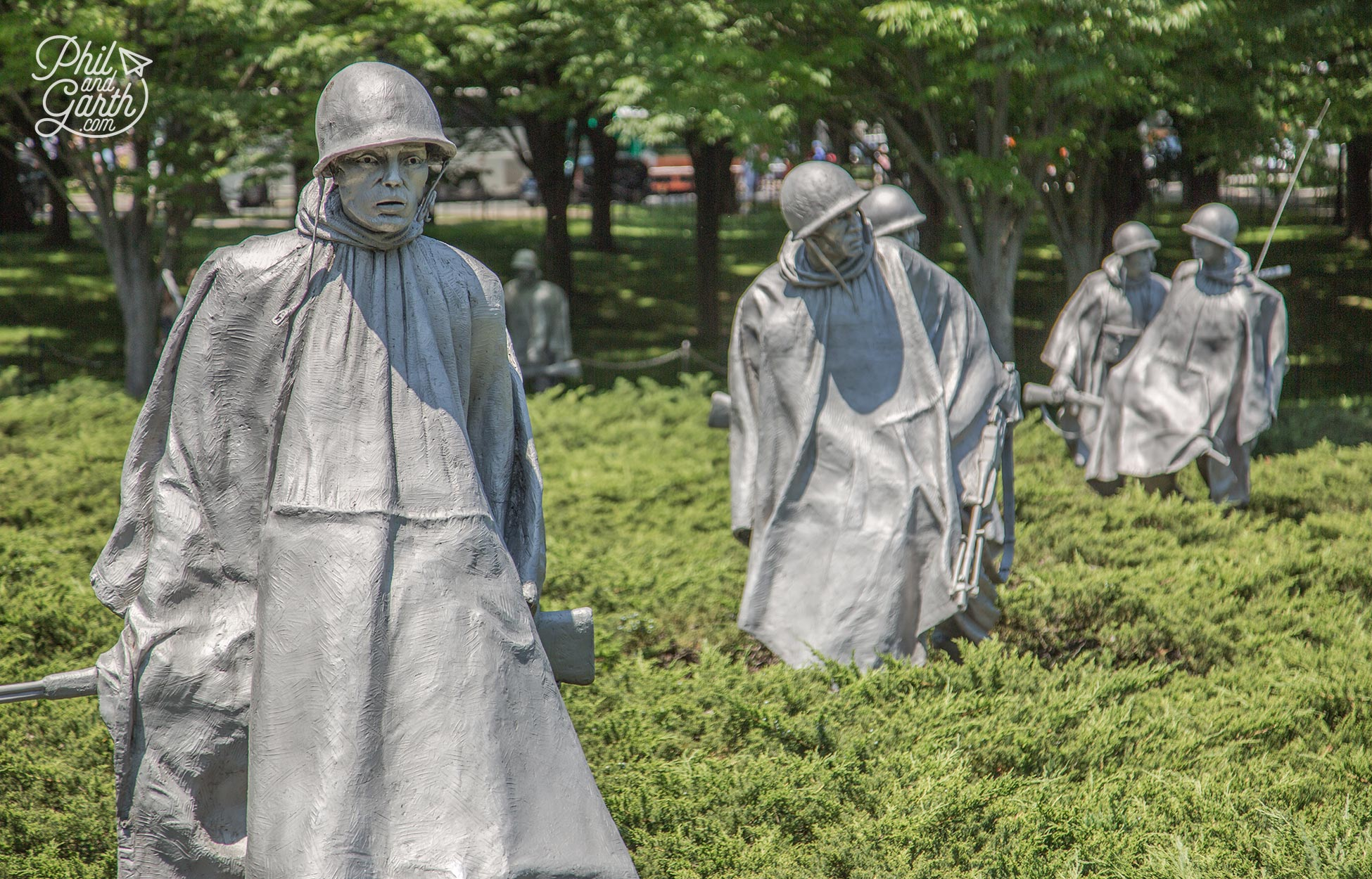 The statues are posed in formation looking in different directions