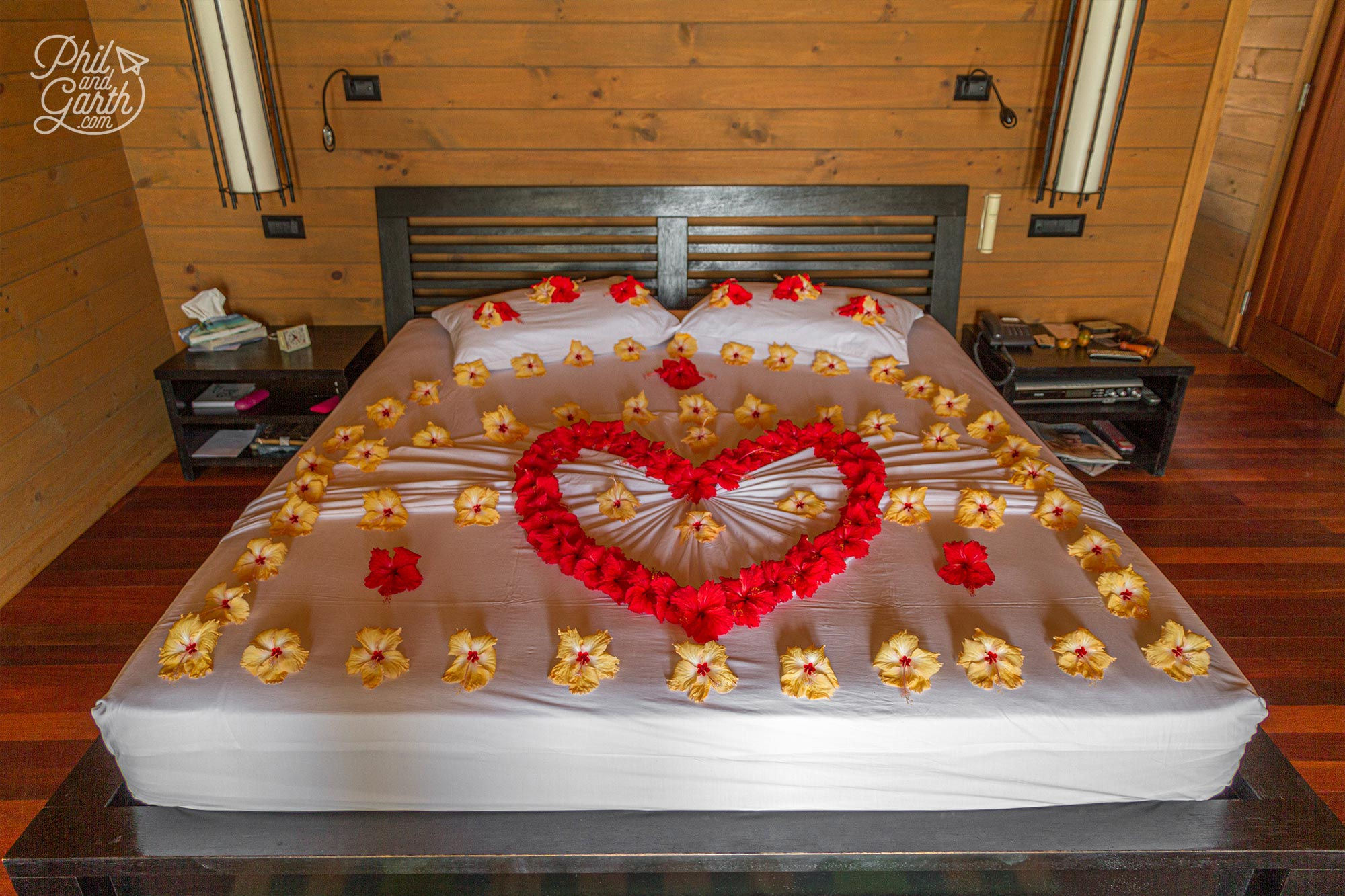 Beautifully decorated bed in our Jacuzzi Water Villa