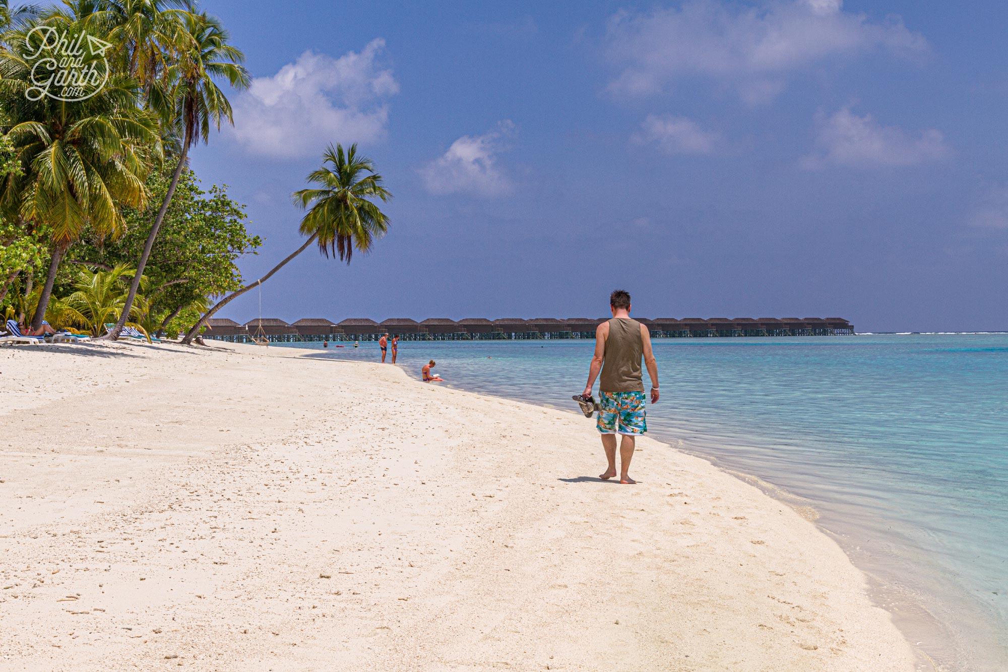 Phil taking a walk down the beach in Meeru Maldives