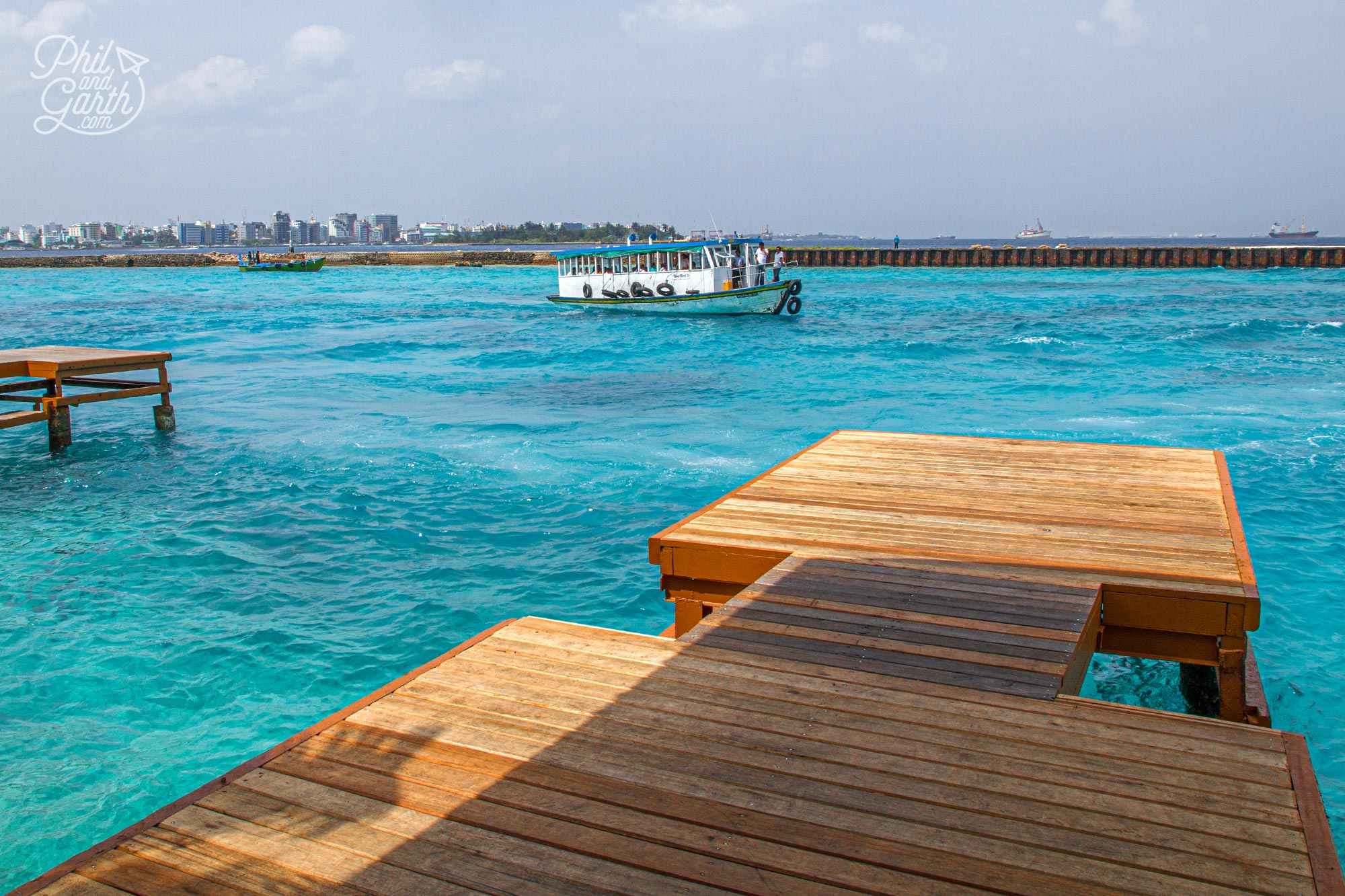 Waiting for our speedboat transfer at Malé International Airport, just look at that turquoise coloured water!