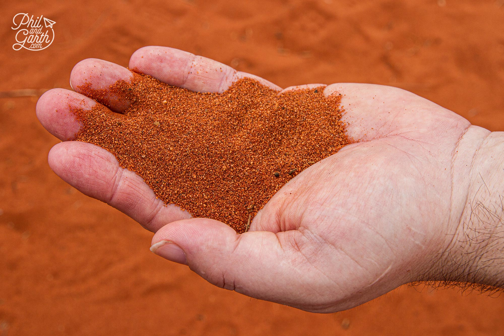 The rock and sand is red because of the iron in the rock which turns rusty