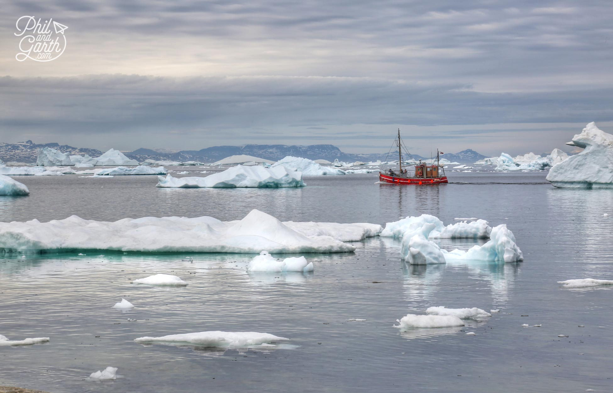 Fishing boat sails through Disko Bay