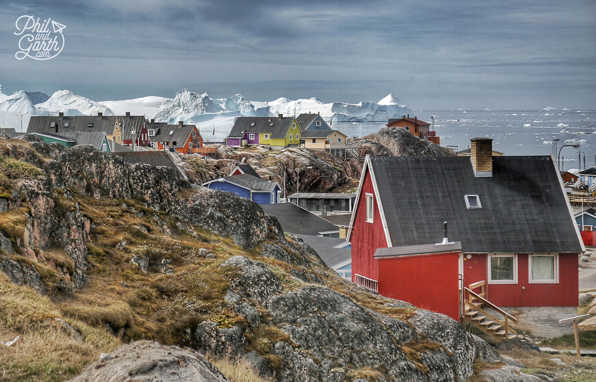 Ilulissat homes and stormy clouds over disko bay