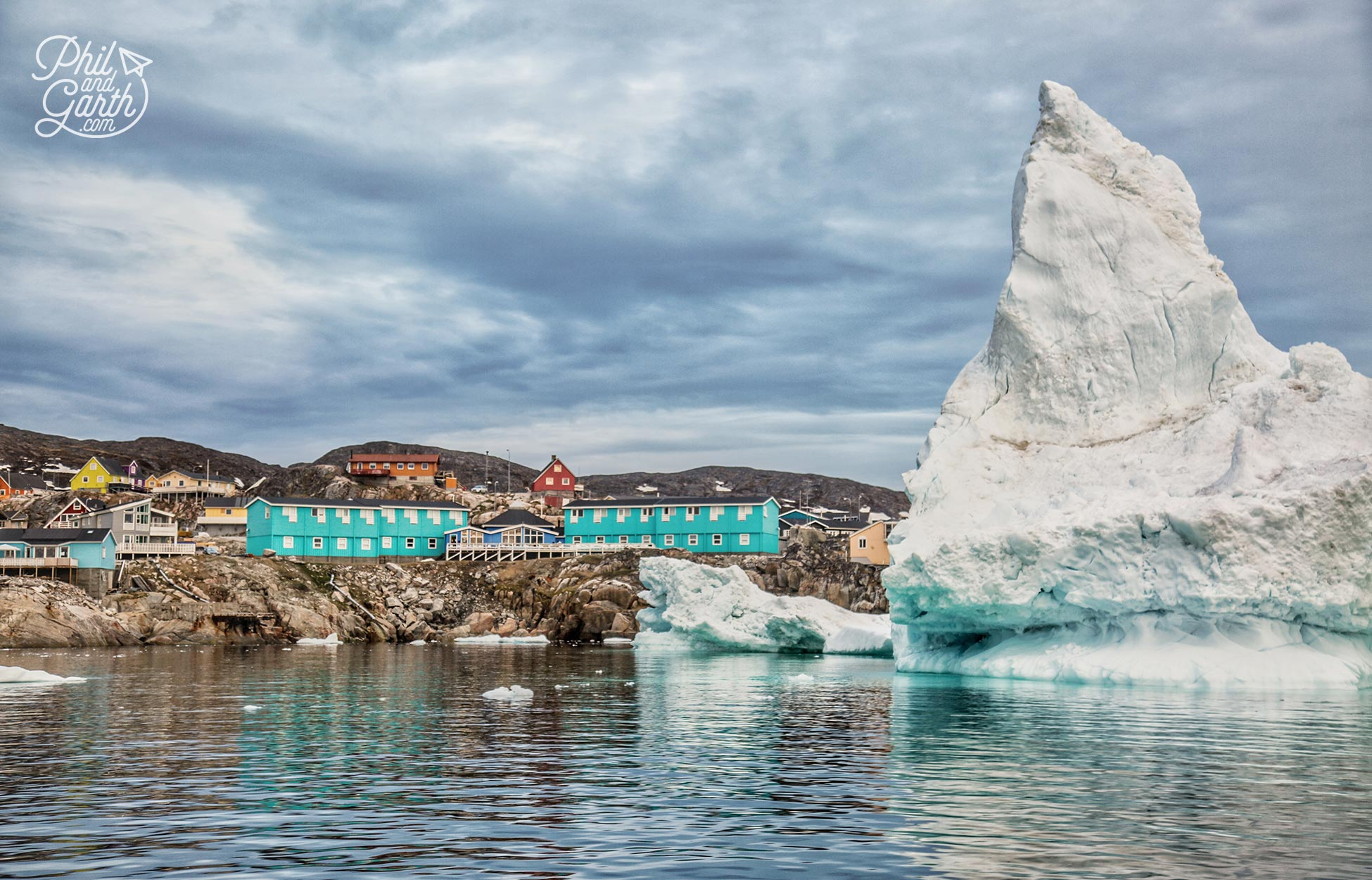 Passing Ilulissat homes and icebergs in Disko Bay