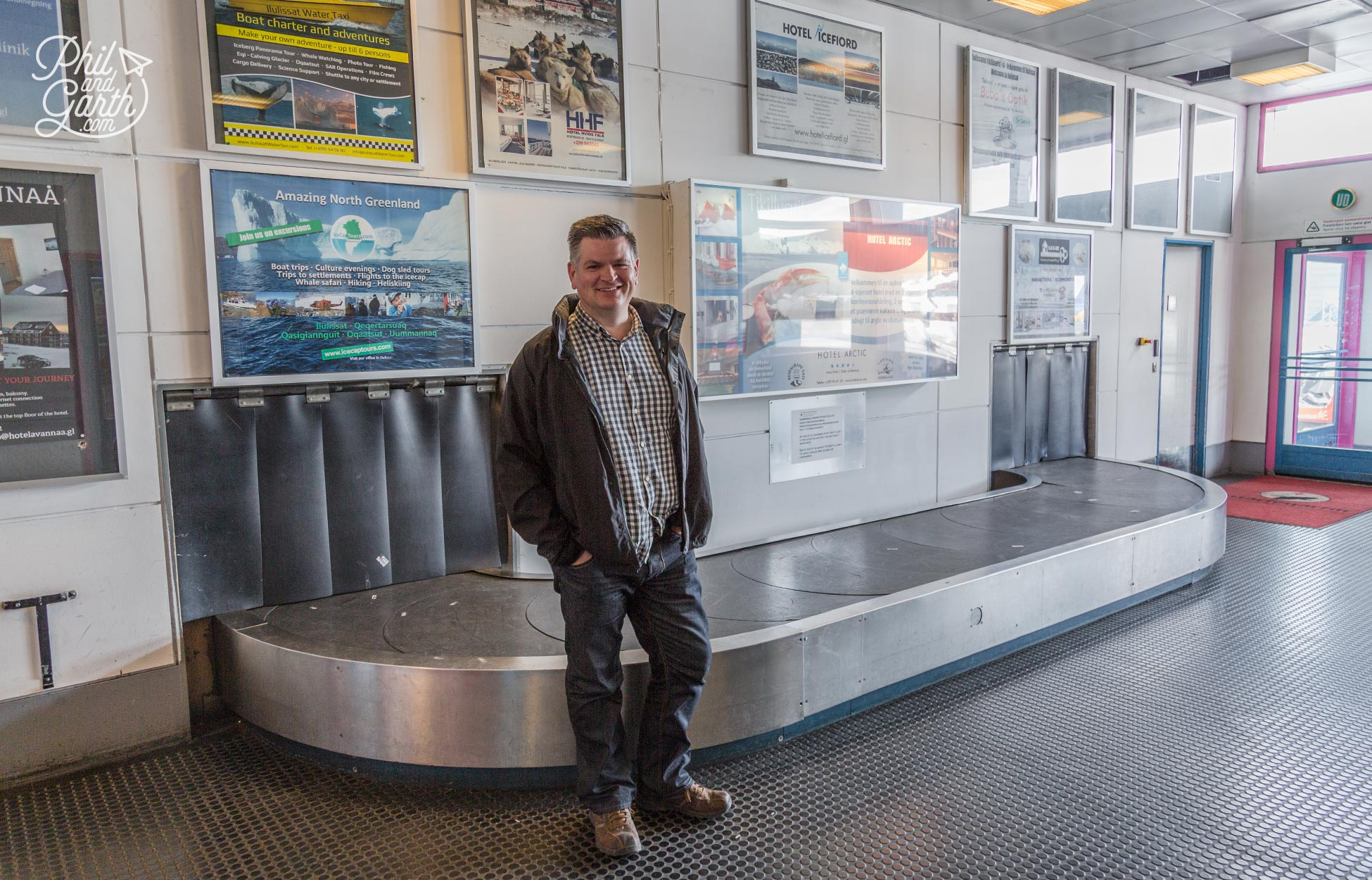 Phil at Ilulissat Airport with what must be the world's smallest baggage carousel