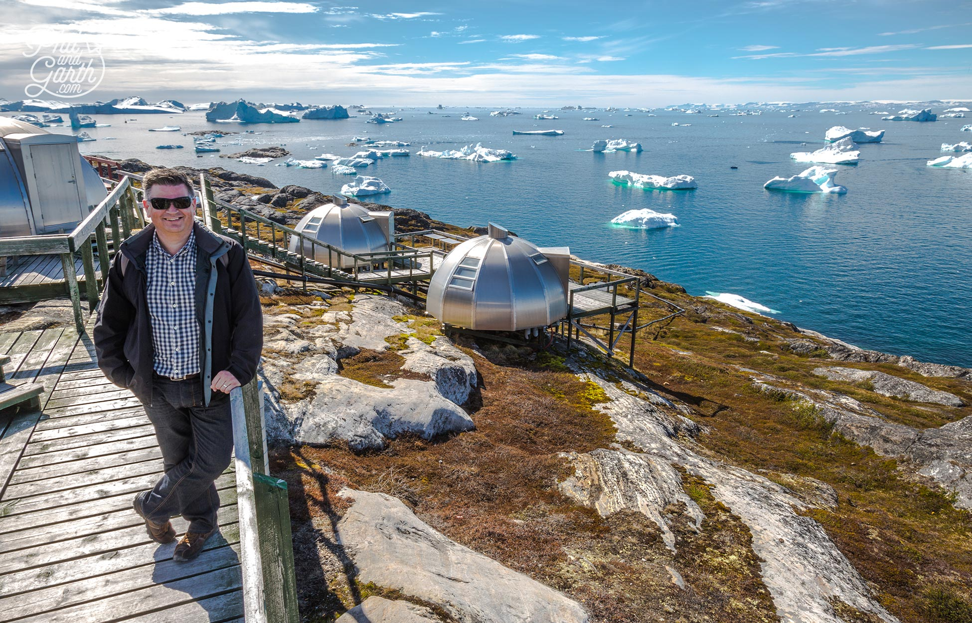 Phil with the aluminium igloos at Hotel Arctic