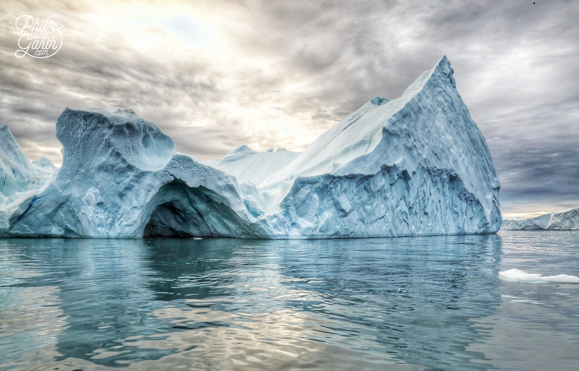 Water movements and the heat from the sun create caves in icebergs