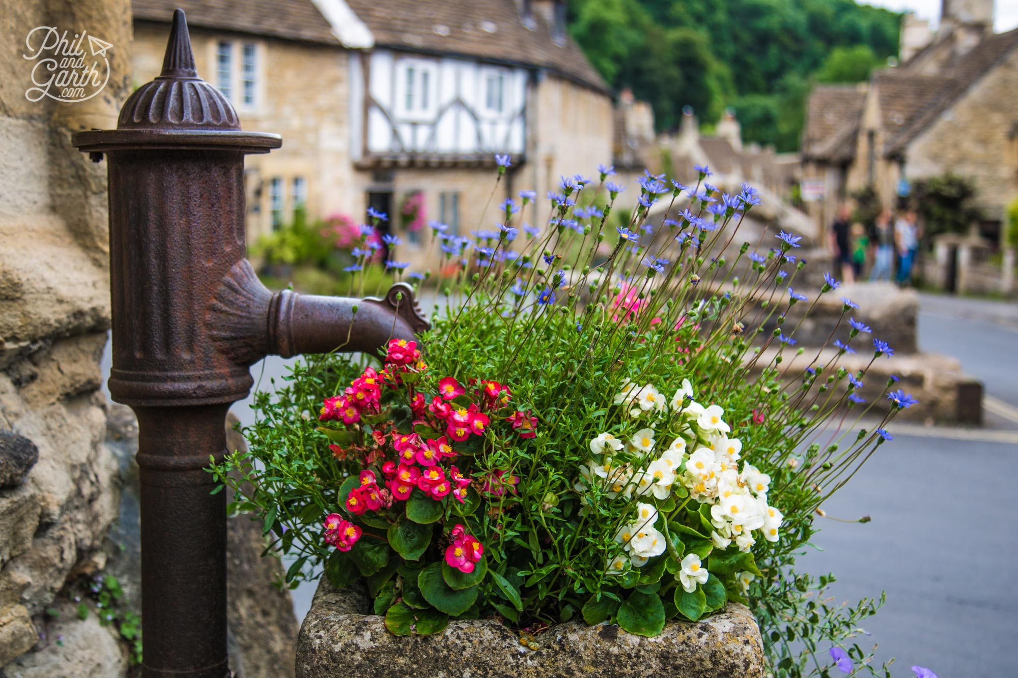 Castle Combe's flower filled village water pump