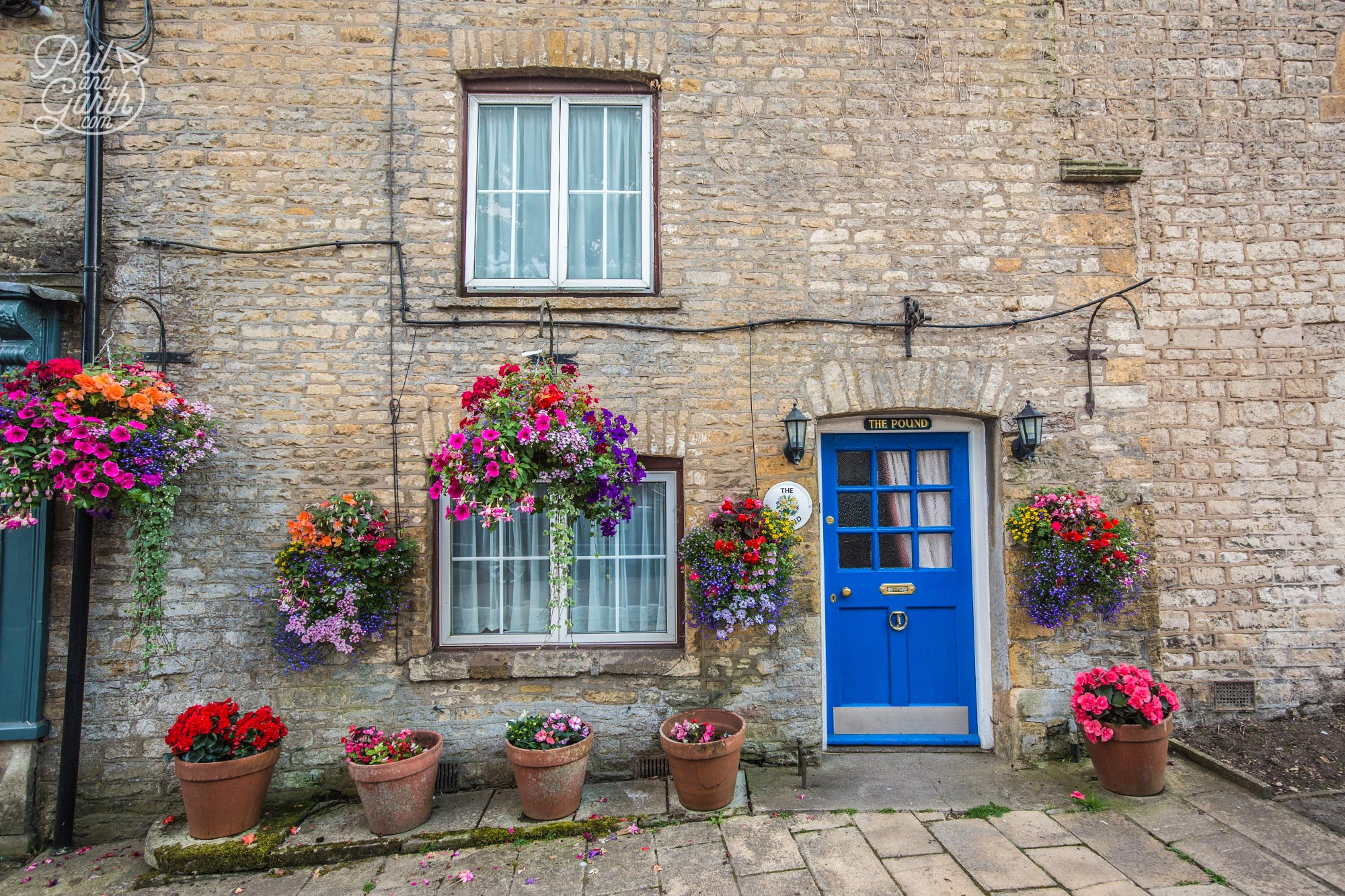 Colourful hanging baskets in Stow-on-the-Wold