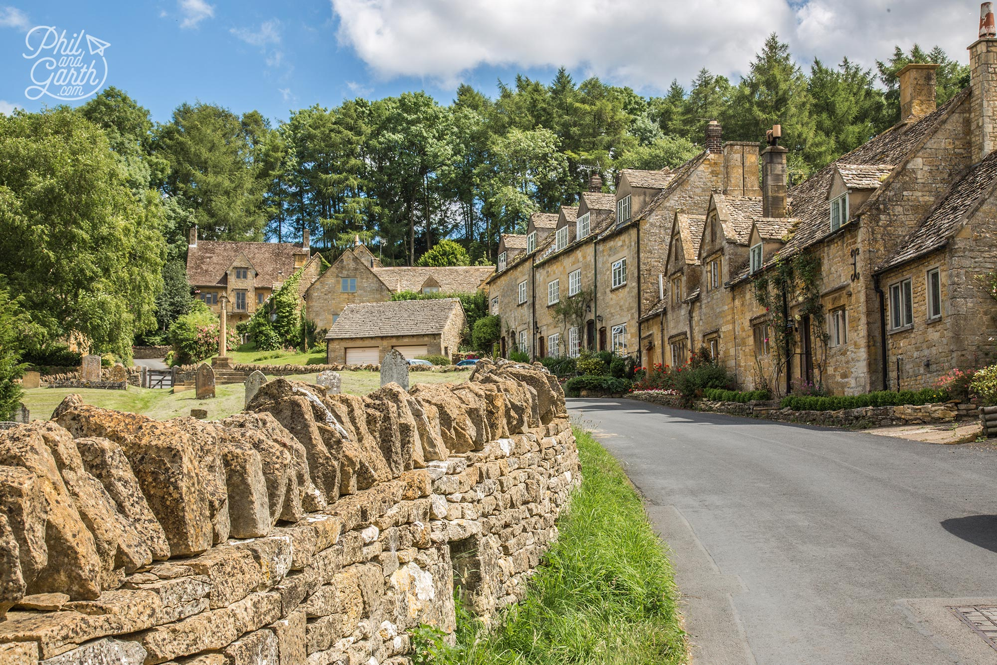 Snowshill dry stone wall and residential homes, The Cotswolds
