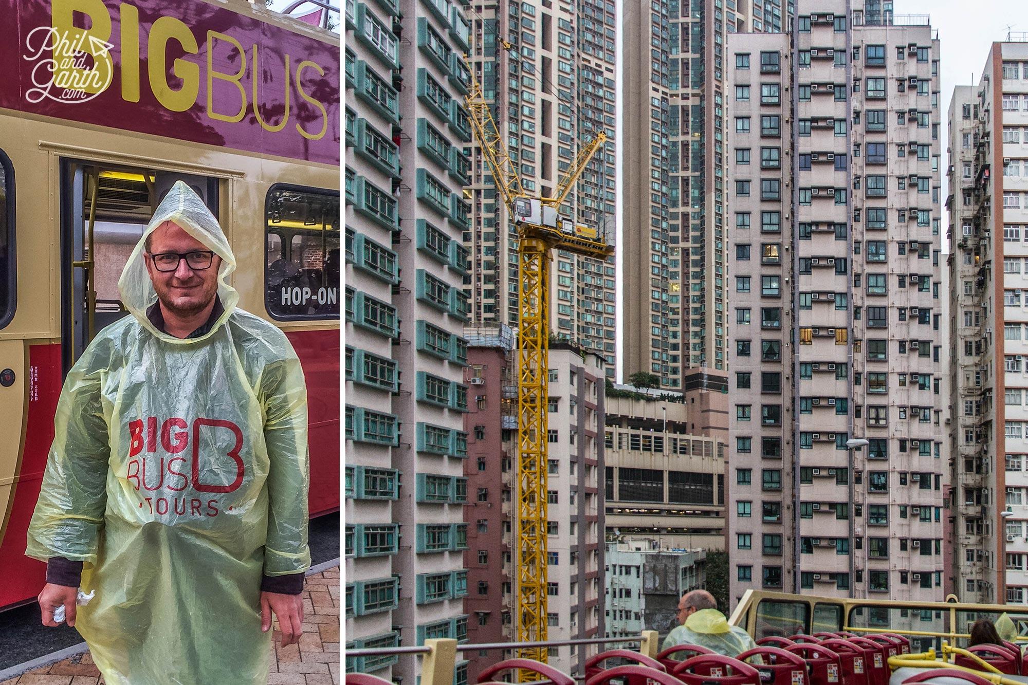 Big Bus Tour travelling past huge high rise apartments