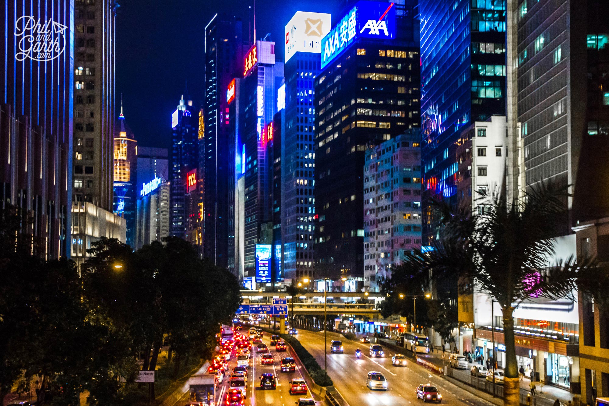 Gigantic neon and LED screens light up streets and buildings