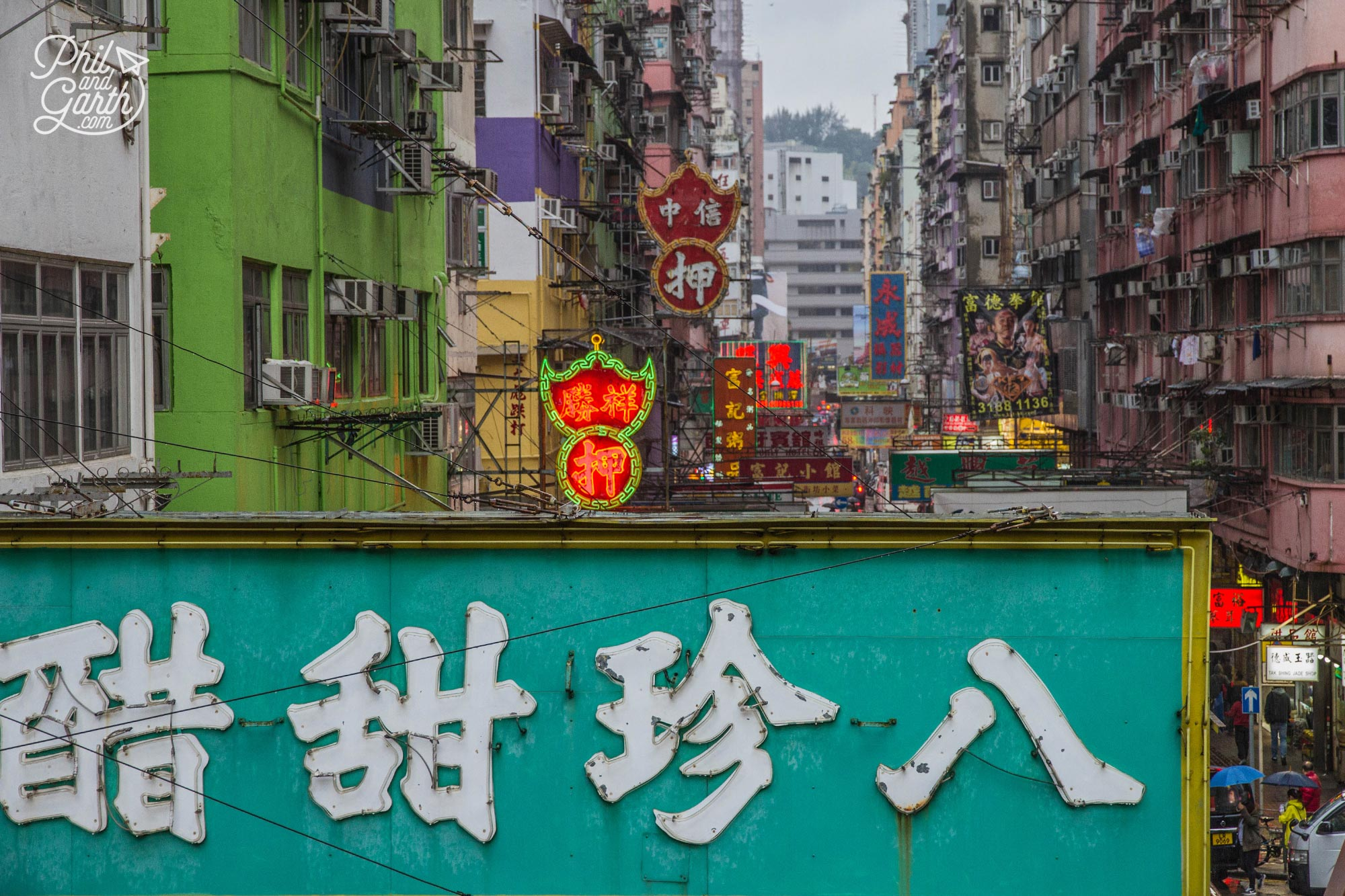 Hundreds of neon signs and lights line the streets of Kowloon