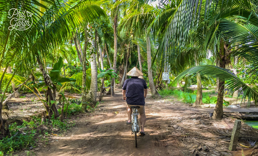 Phil cycling to a Delta village through the jungle.