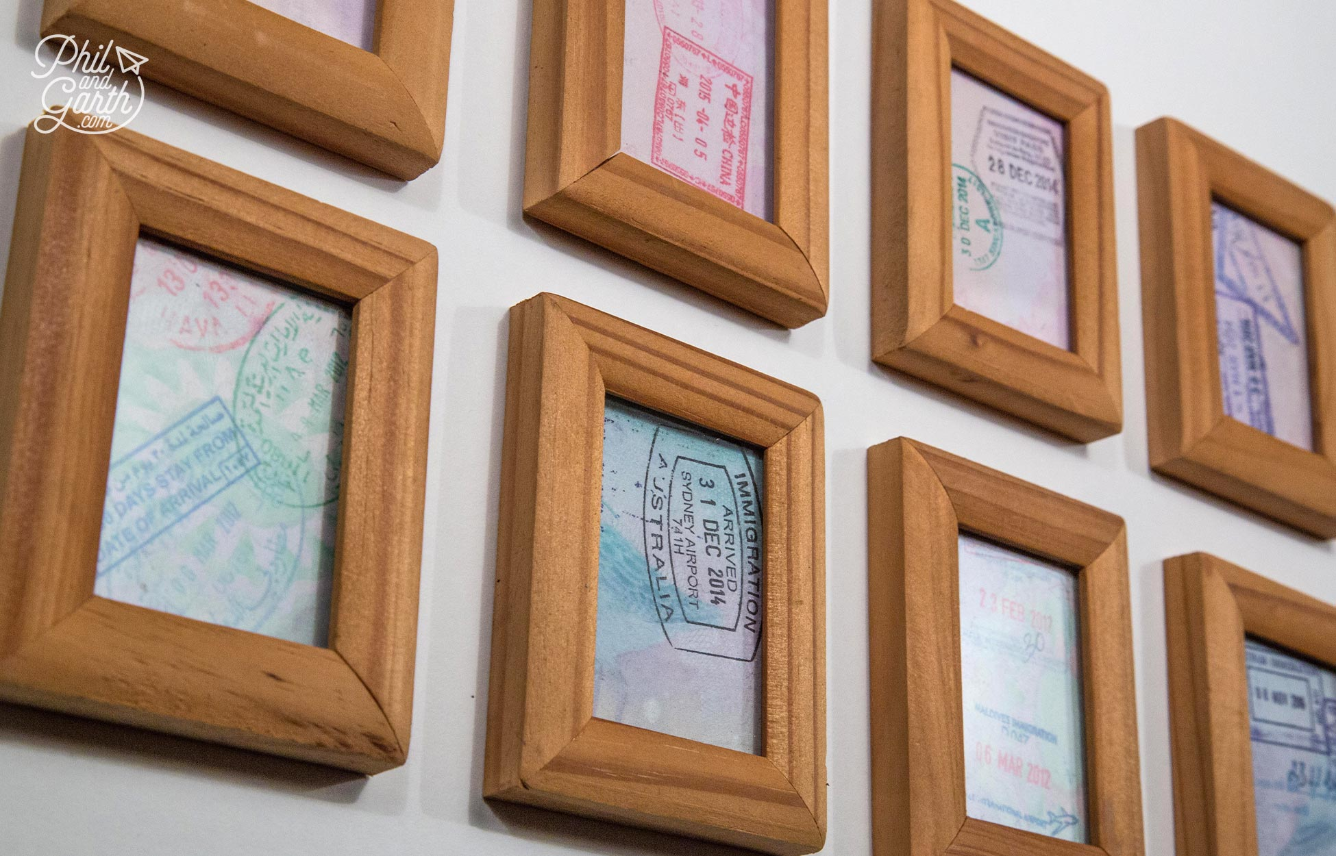 Cut up your old passport pages and put them inside little frames