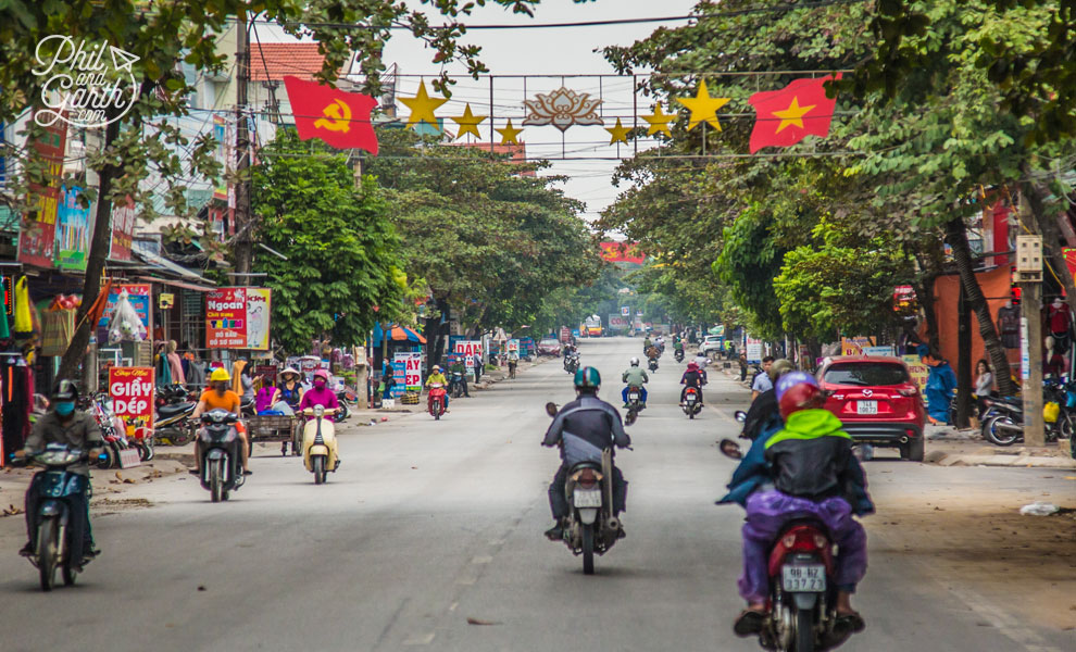 The Communist Party hammer and sickle alongside the Vietnamese flag