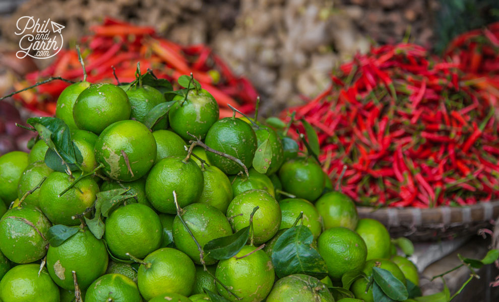Colourful limes and chillies on sale