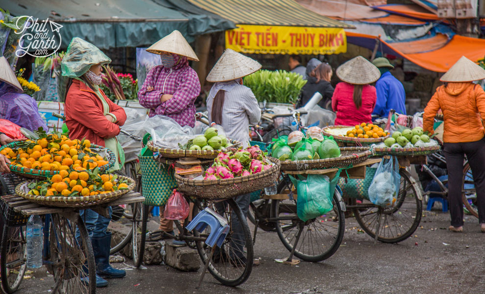 Fruit vendors in their iconic conical hats