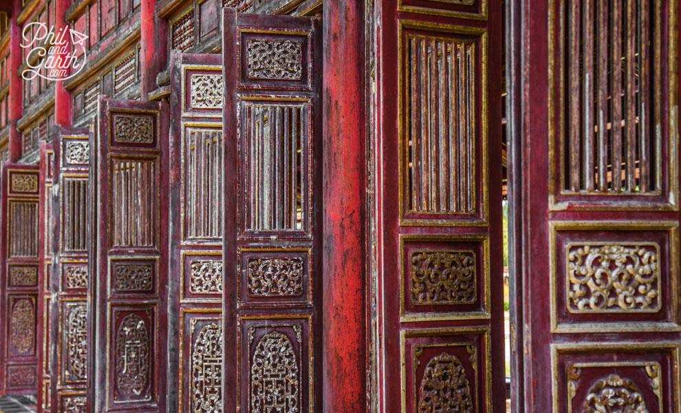 Ornate wooden doors line remaining hallways