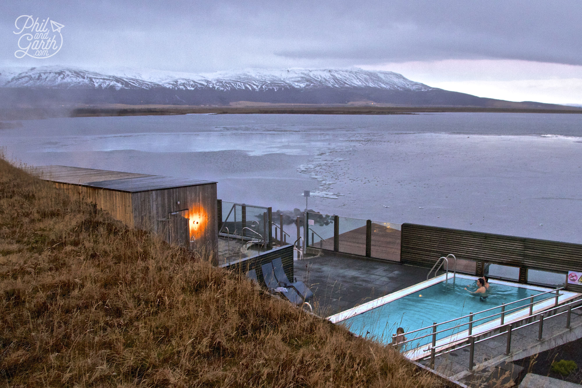 The Best Places To Travel By Month - January for Iceland's dramatic scenery - the backdrop at the Laugarvatn Fontana Spa