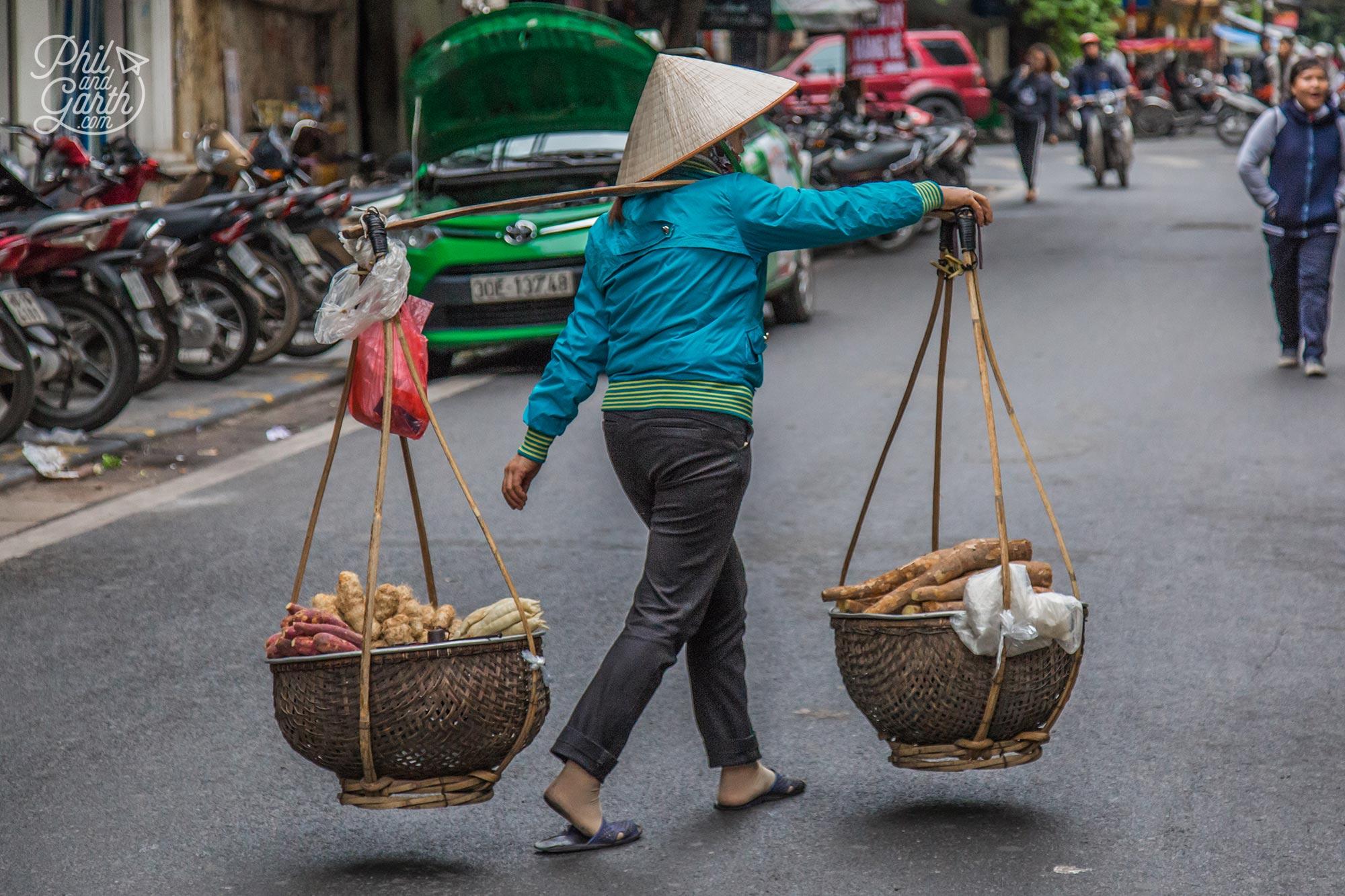 Lady and her yoke selling sweet potato
