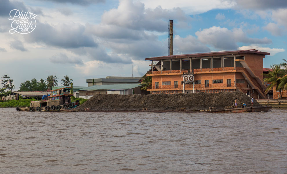 A barge with massive pile of soil