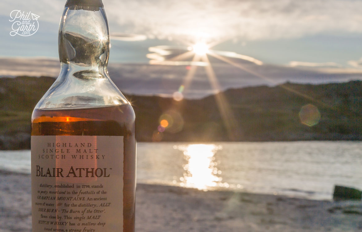 Enjoying a wee dram on the beach watching the sunset