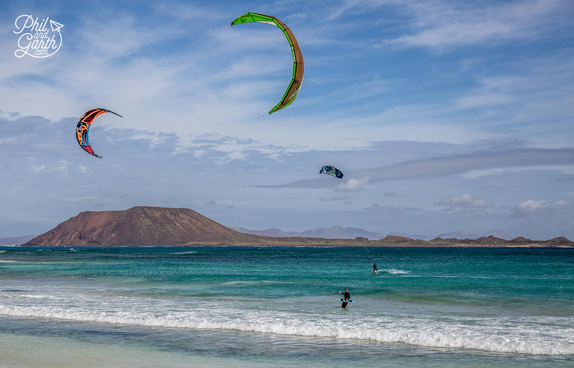 Kite surfers on Grandes Playas with the uninhabited island of Los Lobos in the background