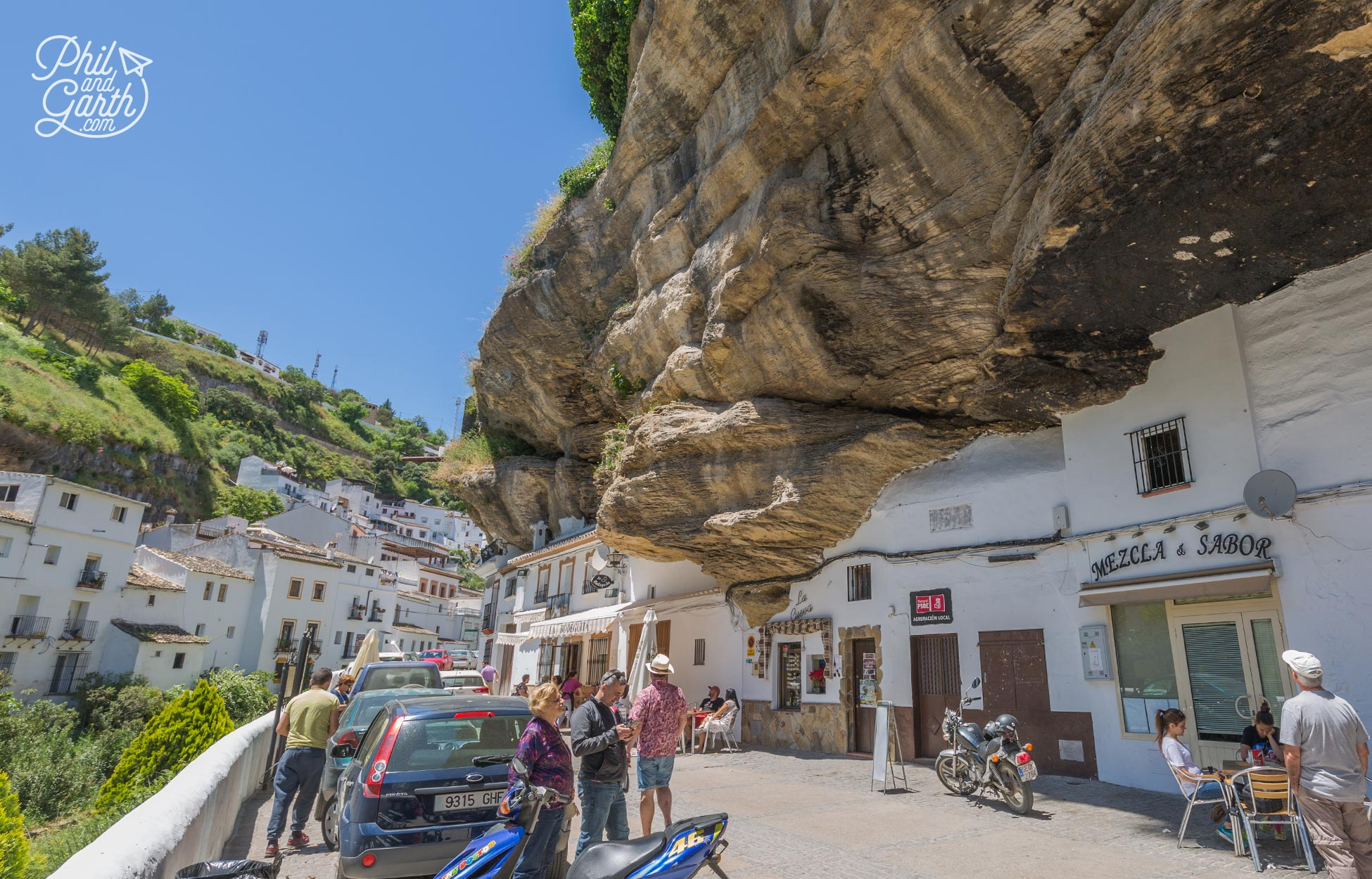 Gravity defying buildings embedded into the rock on 'Sun Street'