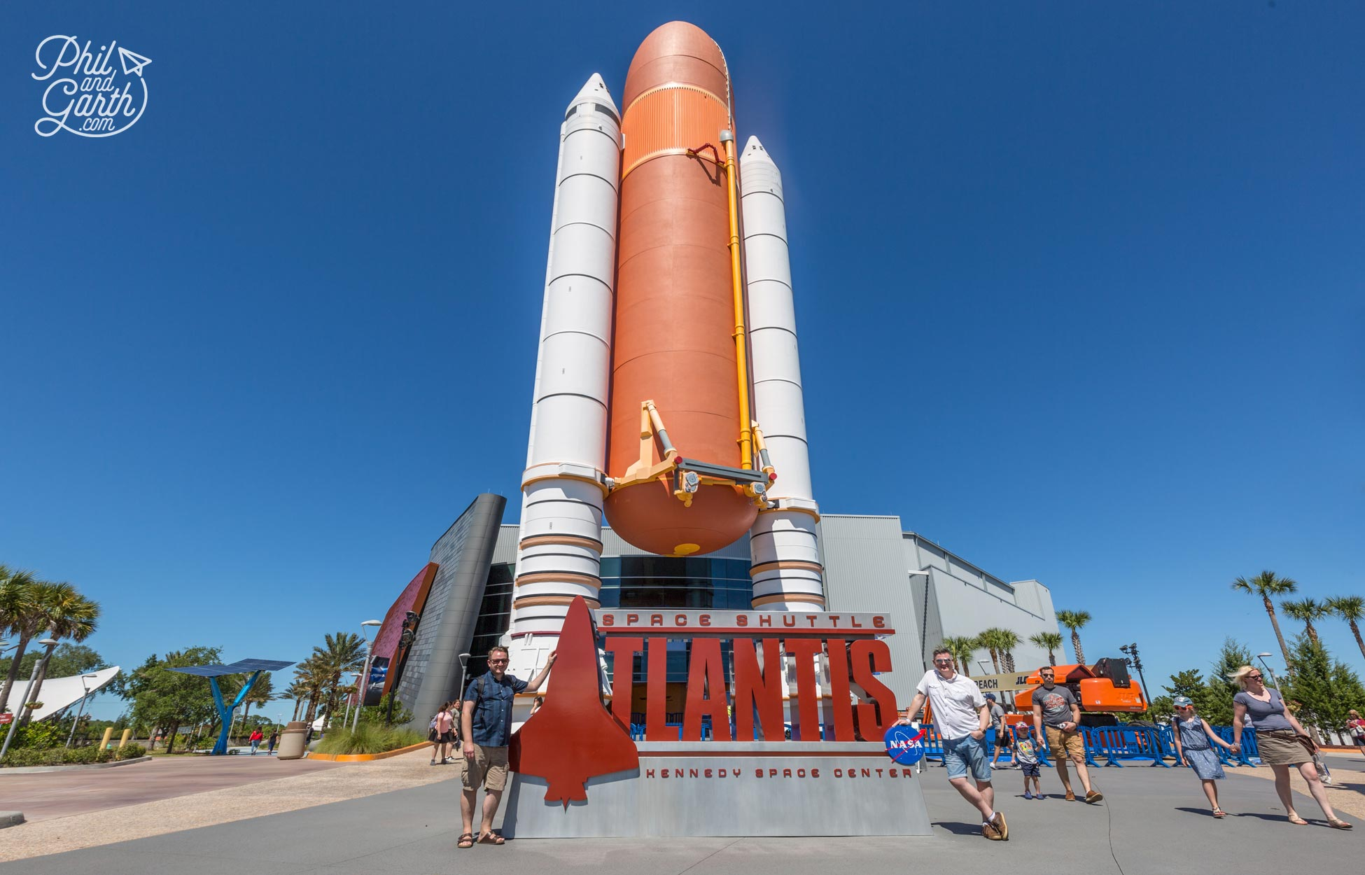 Garth and Phil outside the Space Shuttle Atlantis building