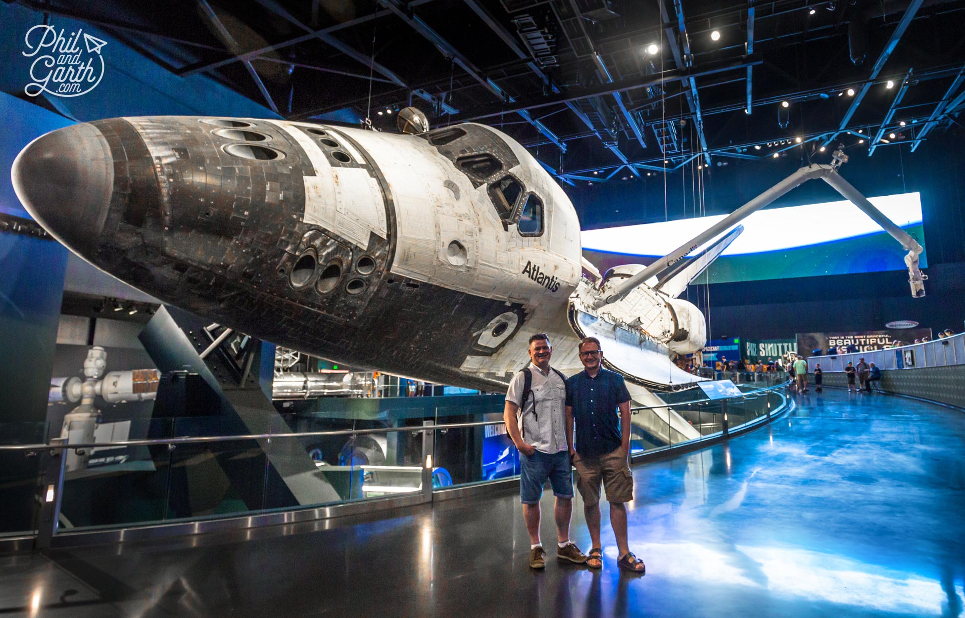 Phil and Garth stood next to Space Shuttle Atlantis