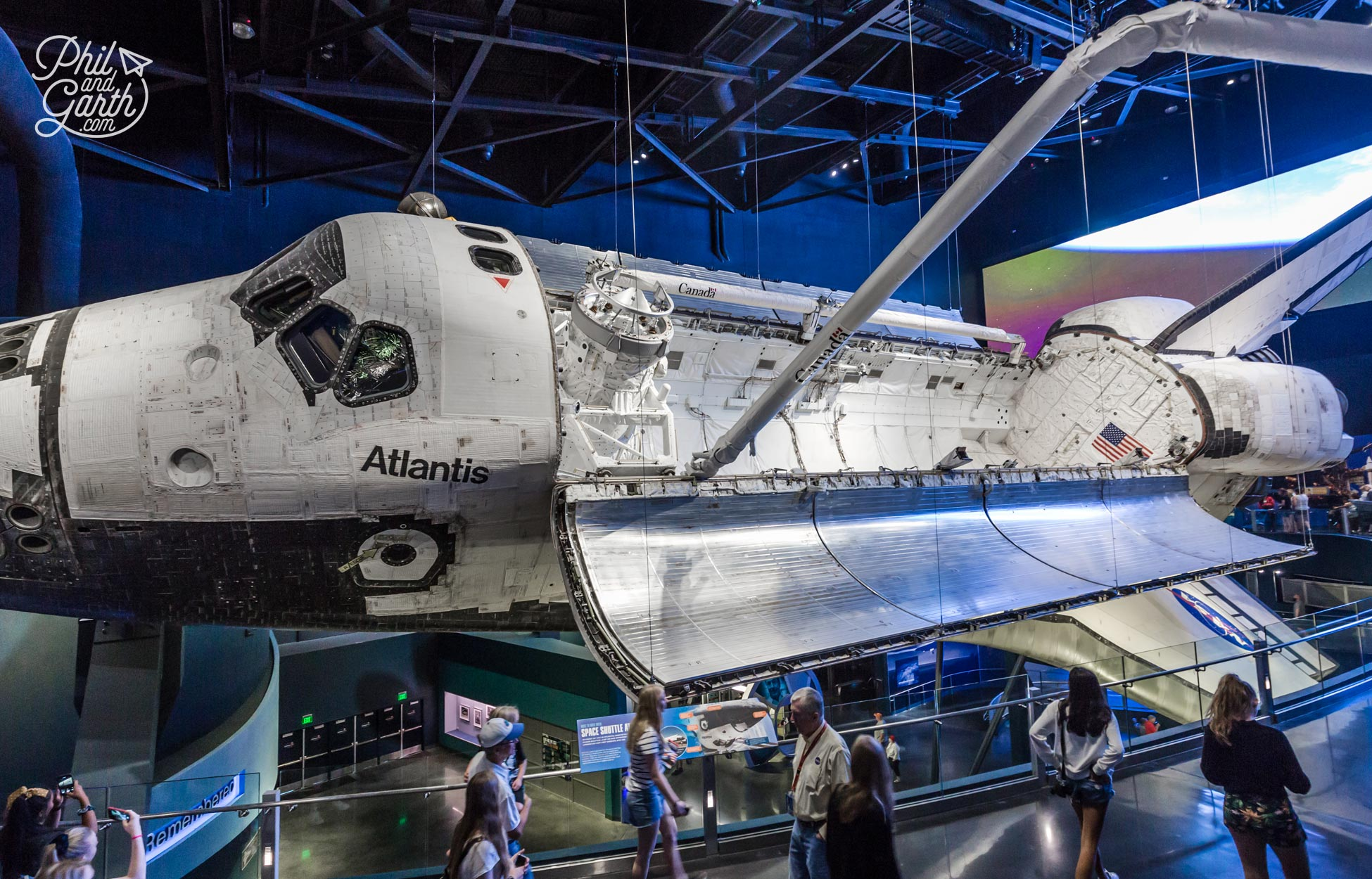 Space Shuttle Atlantis is suspended and angled as if floating in space