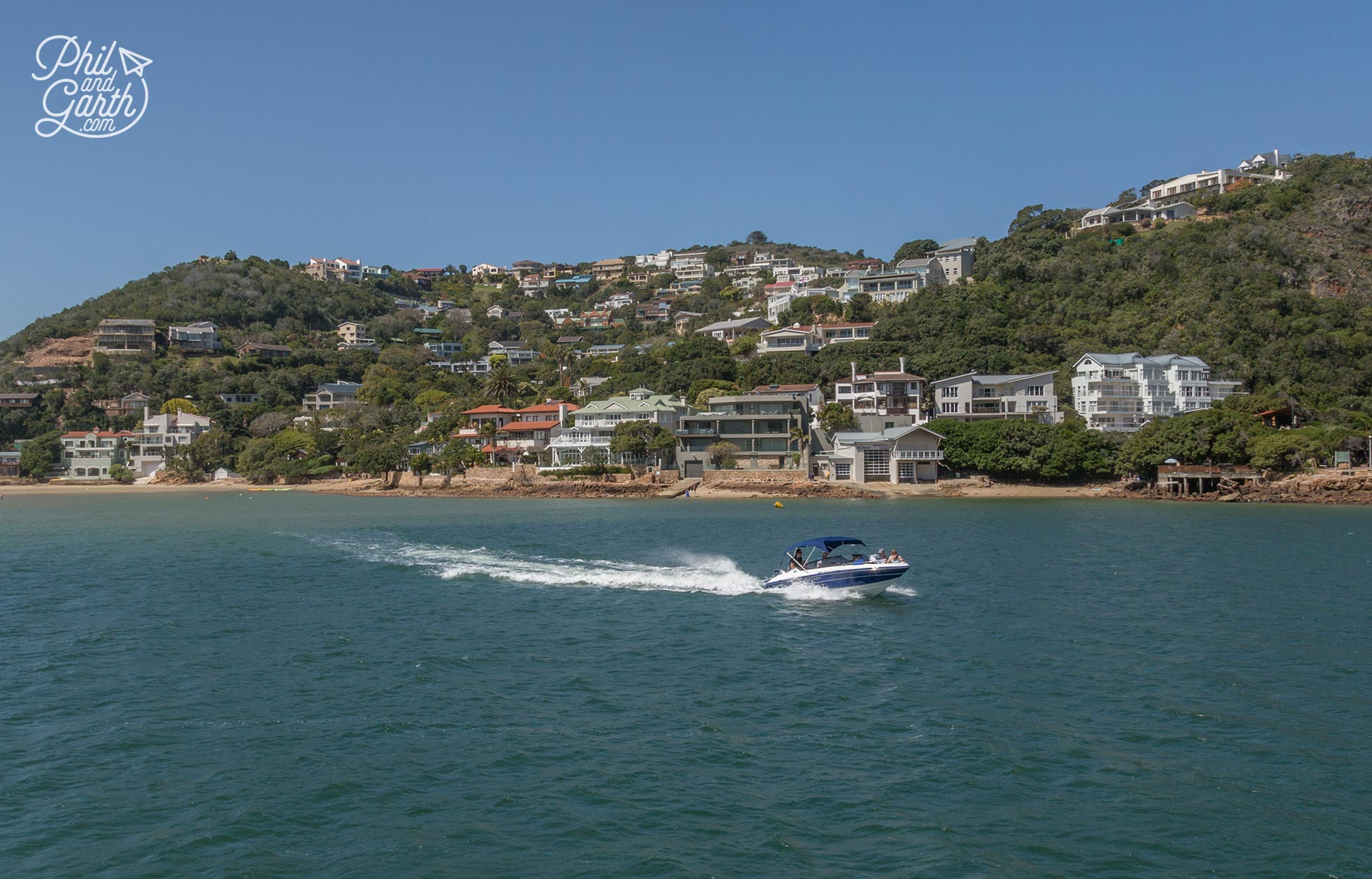 Cruising past rich mansions along Knysna's lagoon