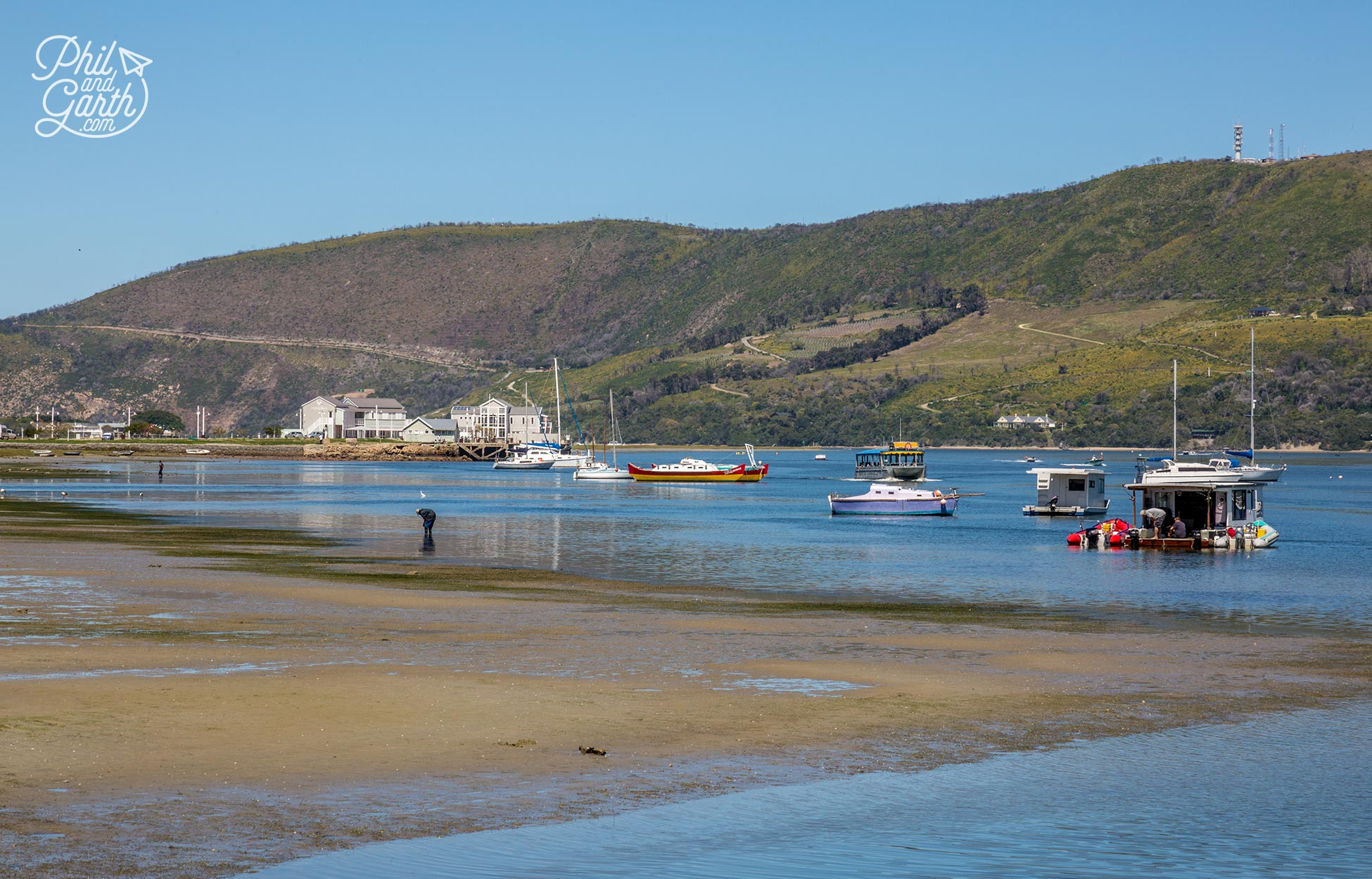 The Garden Route - Boats bob up and down in the lagoon