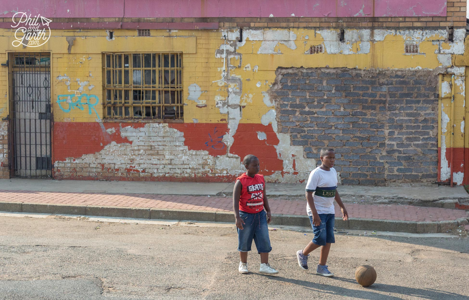 Children playing football in the streets of Soweto
