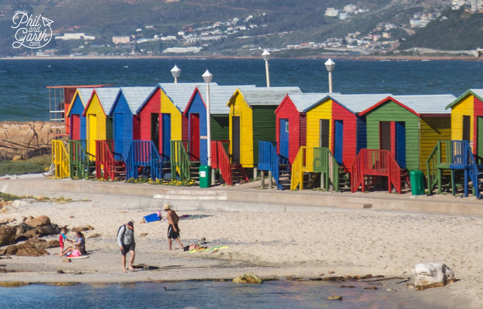 Just some of the colourful Victorian beach huts at Muizenberg Beach