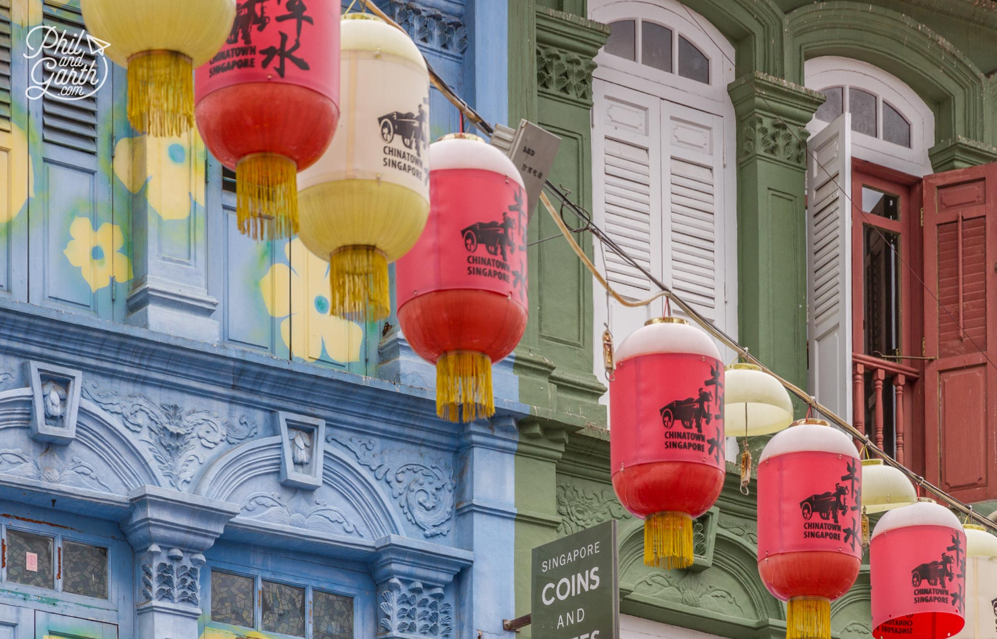 Don't forget to look up at the colourful shophouse facades and lanterns overhead