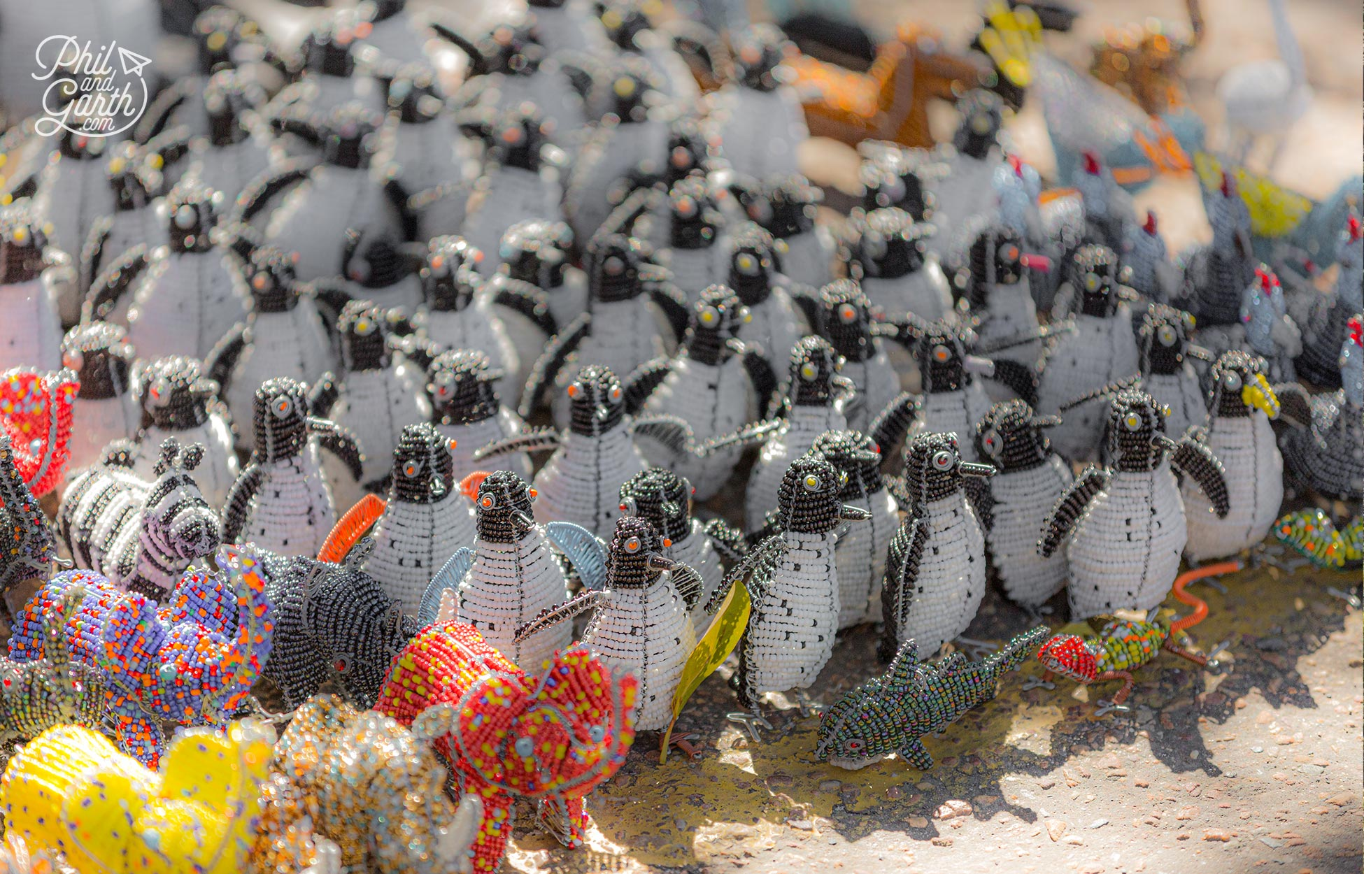 Loads of penguin themed souvenirs outside Boulders