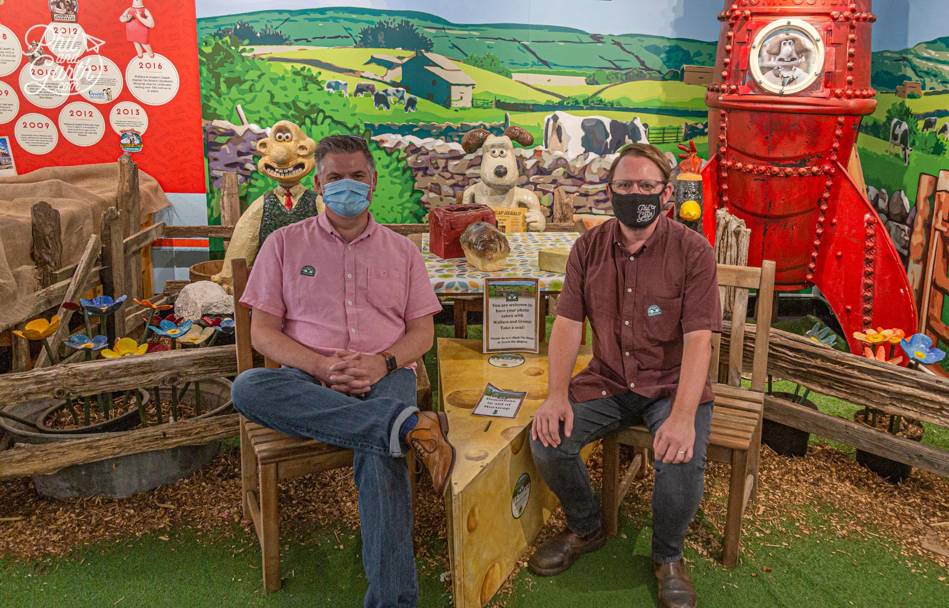 We are smiling under the masks! The must have photo with Wallace and Gromit at the Wensleydale Creamery