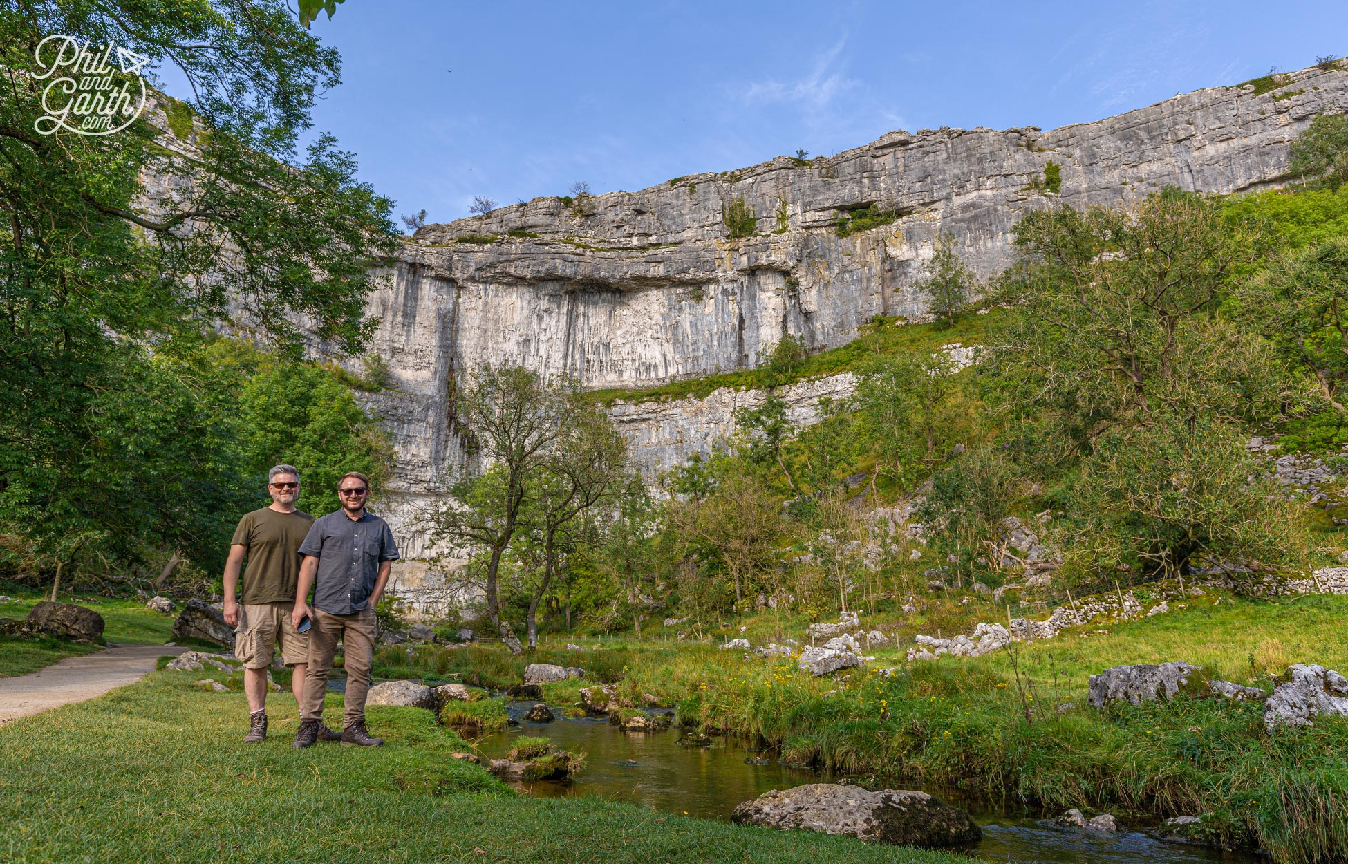 Phil and Garth next to the 80 metre high limestone cliffs of Malham Cove