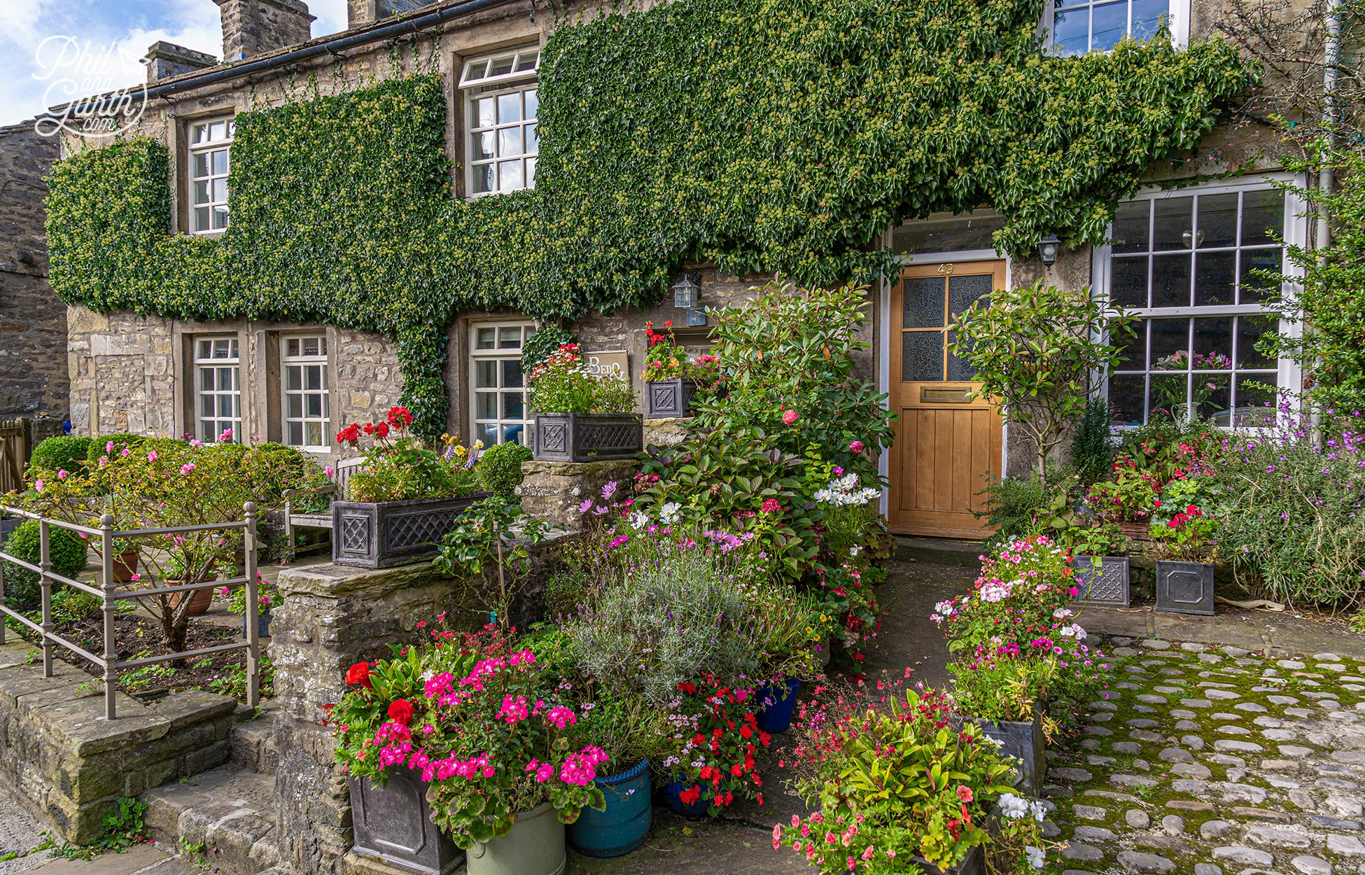 Pretty flower filled front gardens in Grassington