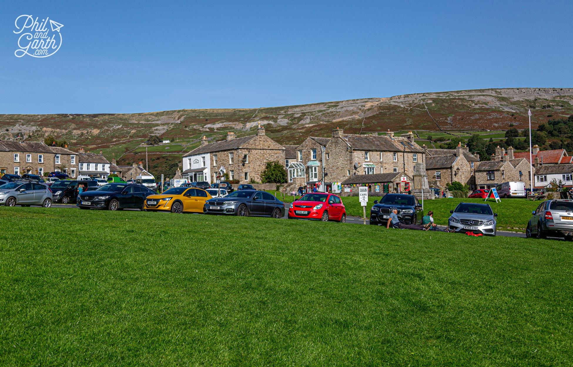 Reeth's village green is surrounded by pubs, shops and homes