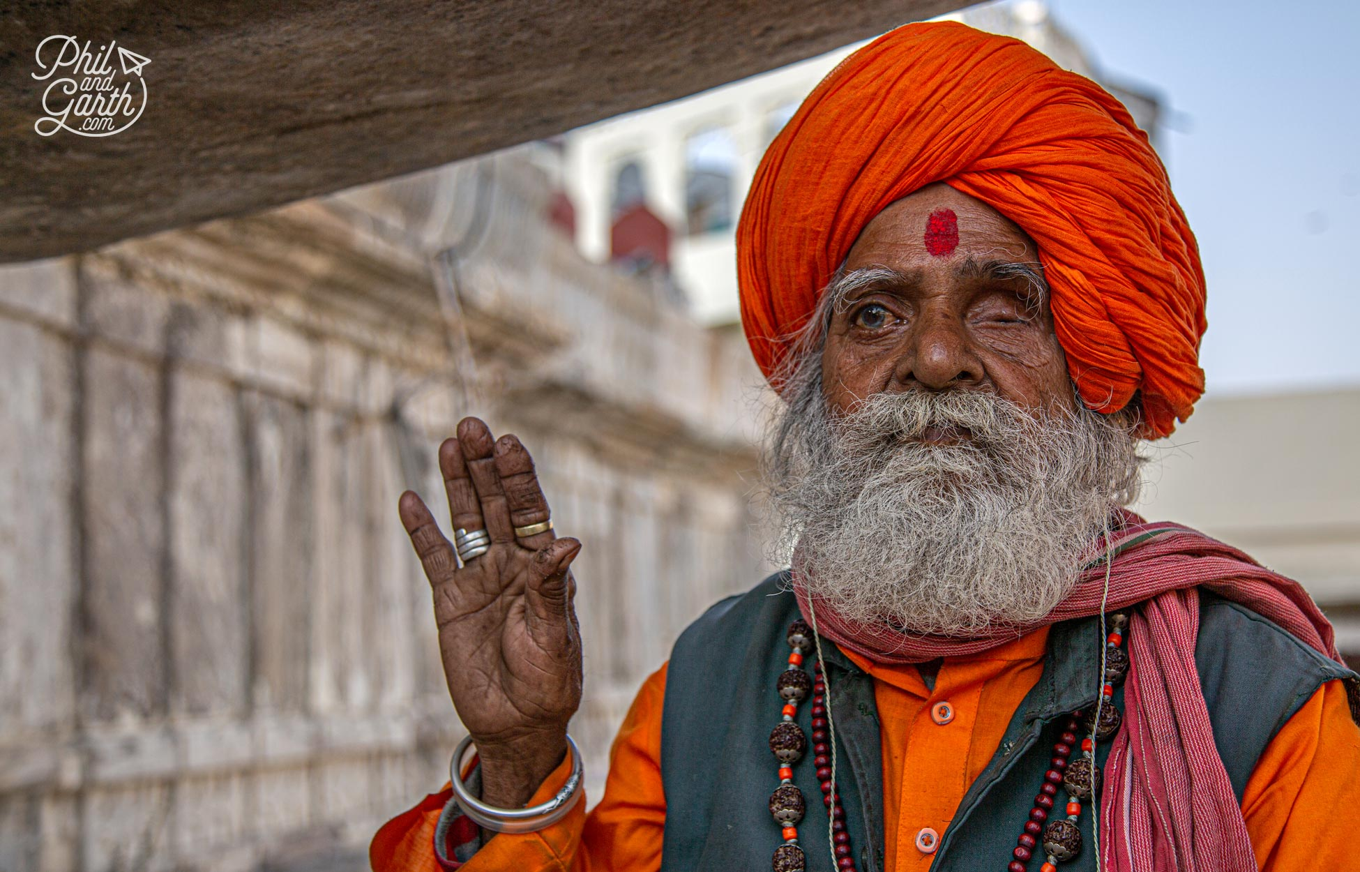 Sadhus sit outside the entrance to the Jagdish Temple. If you want to take pictures ask them first and offer some rupees